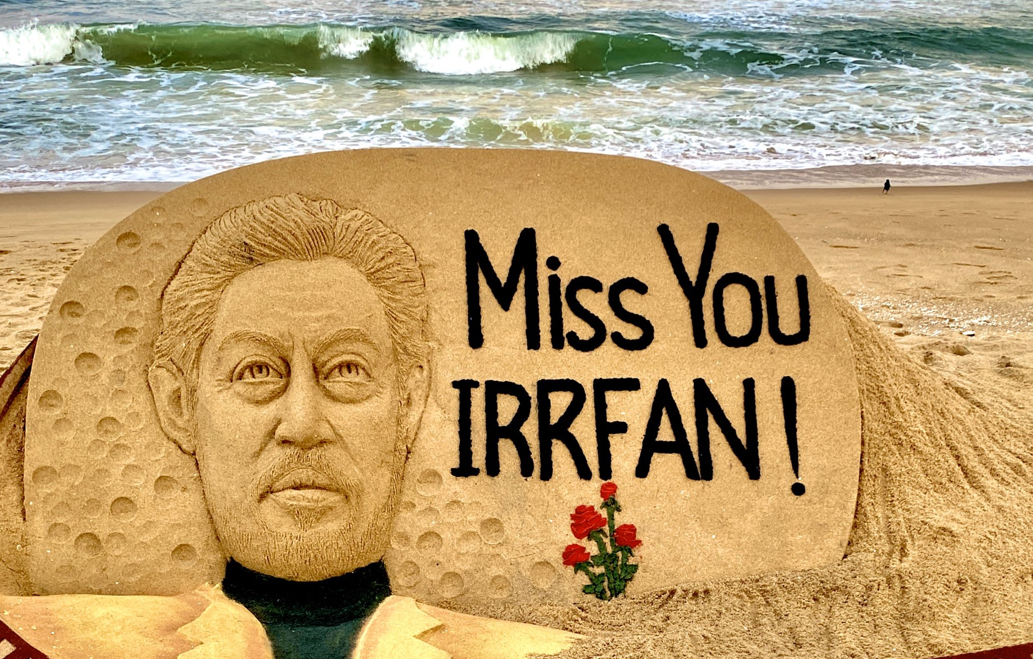 "Renowned sand artist Sudarsan Pattnaik on Wednesday gave a 'Sandy Tribute' to Actor Irrfan Khan through his sand art at Puri Beach in Odisha. Taking to Twitter, Pattnaik posted a picture of his sand art where he has drawn the actor's face on a sand tombstone and has written ""Miss You Irrfan!"" next to it."