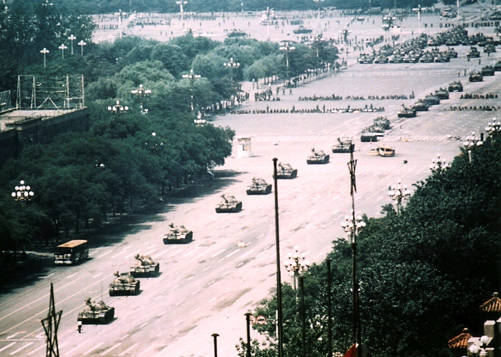 The full Tiananmen Square tank man picture is much more powerful than the cropped one