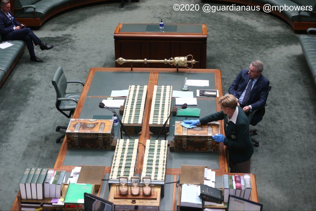 A Reps attendant cleans the despatch box before #qt @GuardianAus @AmyRemeikis #PoliticsLive