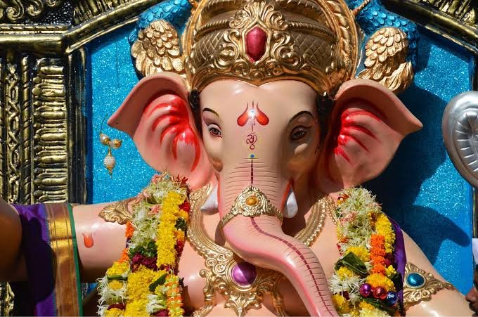Secret of Ganesha. (In words of a Yogi) With a calm and bright face and a slight smile Yogiji said - Look at that picture what do you see? Me- Lord Ganapati Yogiji- have you ever thought why is he like that? Me- No Swamiji, forgive me but it does look a bit strange.