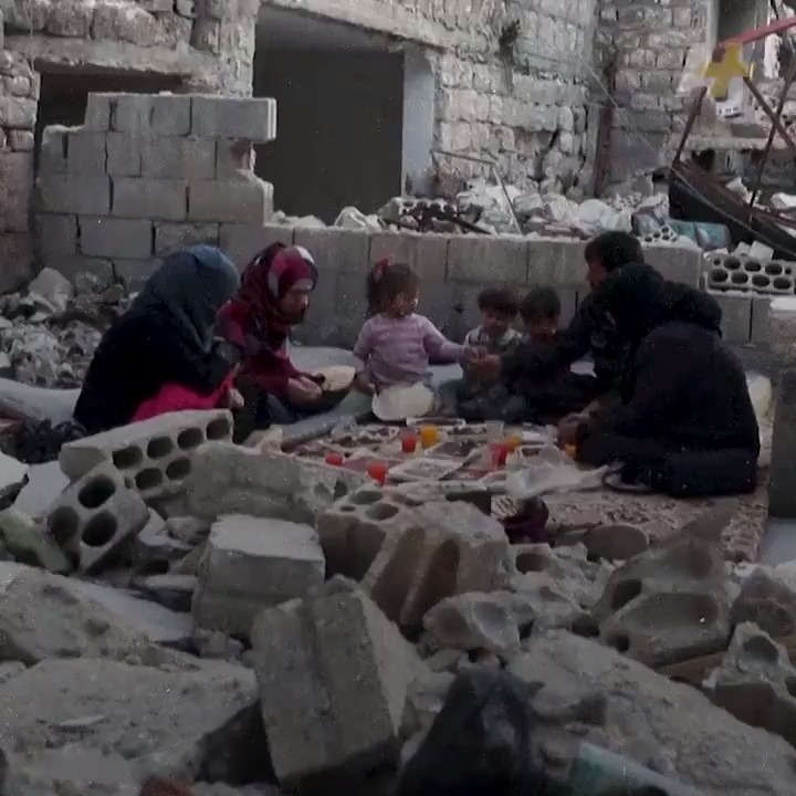 This family is breaking their Ramadan fast in the rubble of what used to be their home in Syria.