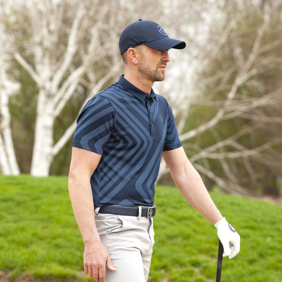MALONE // Short sleeve golf shirt with exceptional breathability. Available in Black & Navy. #galvingreen