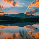Image for the Tweet beginning: Sunset reflections.🌄  Photo by: @scoobuhhsteve on