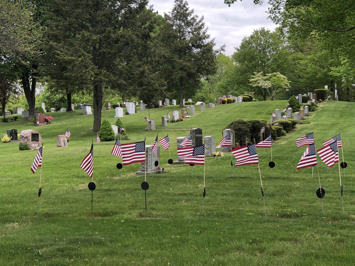 Honoring veterans on a somber day. Woodlawn Cemetery. Wellesley, Massachusetts.