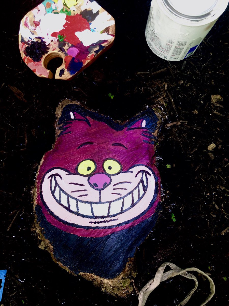 I painted this guy in a tree stump in our forest that I thought looked like a cat.  and of course he needed a theme in this #garden #AliceInWonderland pic.twitter.com/L5uGH48s8N