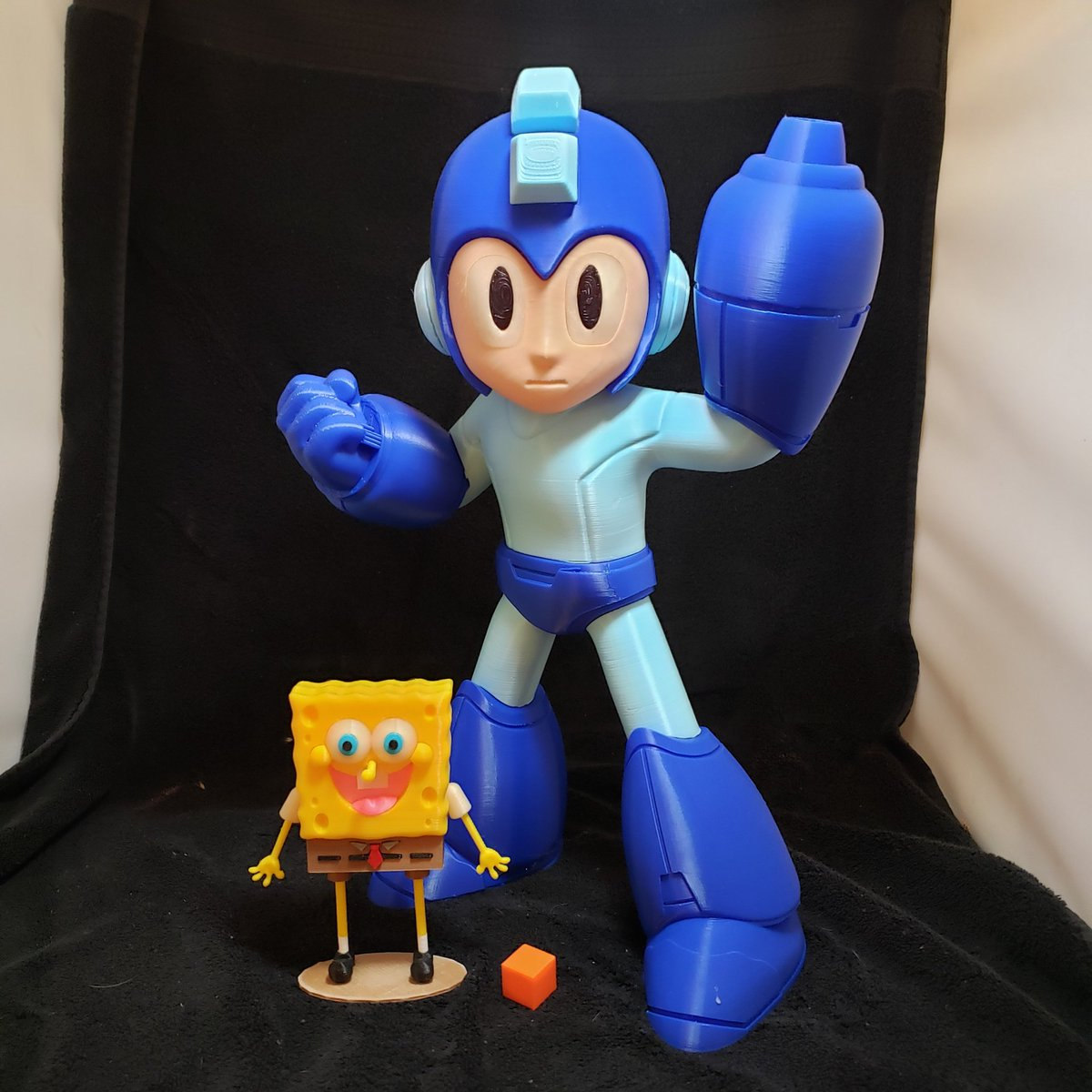 Two of the coolest things I ever printed, that sponge bob was created by the great @theREALwelbot every part is a print, no paint, aside from mega man's pupils. #3dprinted #3dmodeling #3dtechnology #3dprinter #3dmaker #pla #bowden #fdmprinter #ed3 #filament #maker