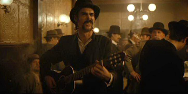 Nick Cave also made a cameo in the film as a busker… just look at him.