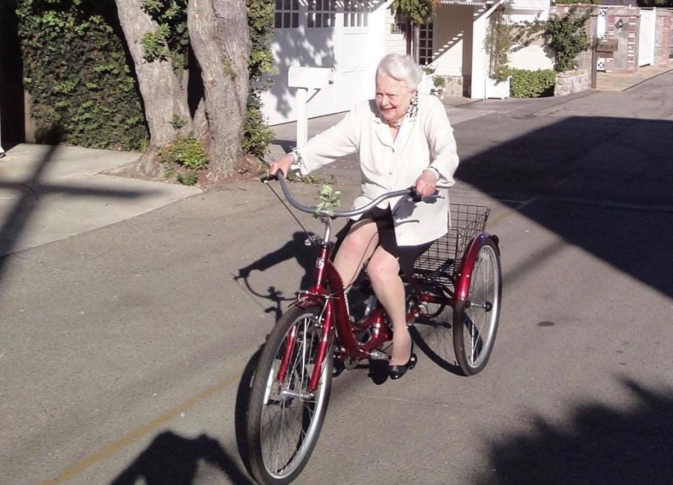 Olivia de Havilland rides a bike at age 103.