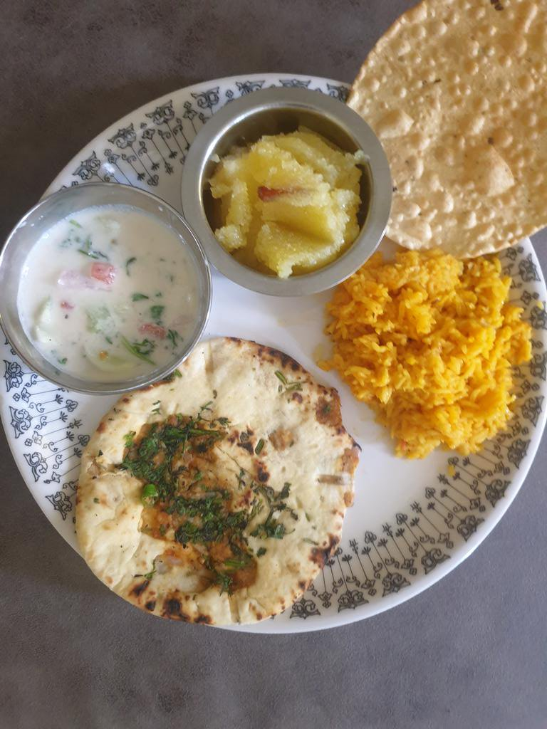 When WFH is not so much,  Lunch gets a special touch   Stuffed naan, khichdi, raita, papad and sheera  #homemade #foodie #LunchTime #tuesdayvibes #goodafternoonpic.twitter.com/uwzwrBMtNy
