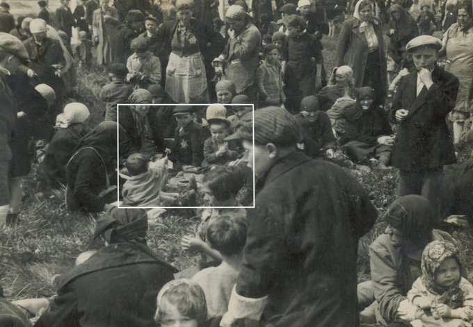 A heart-breaking moment from an SS picture of Hungarian Jews at #Auschwitz II-Birkenau taken probably 76 years ago today. #OTD  A little child found a dandelion in the grass and is handing it or showing it to an older boy. All the people in this picture were gassed moments later.