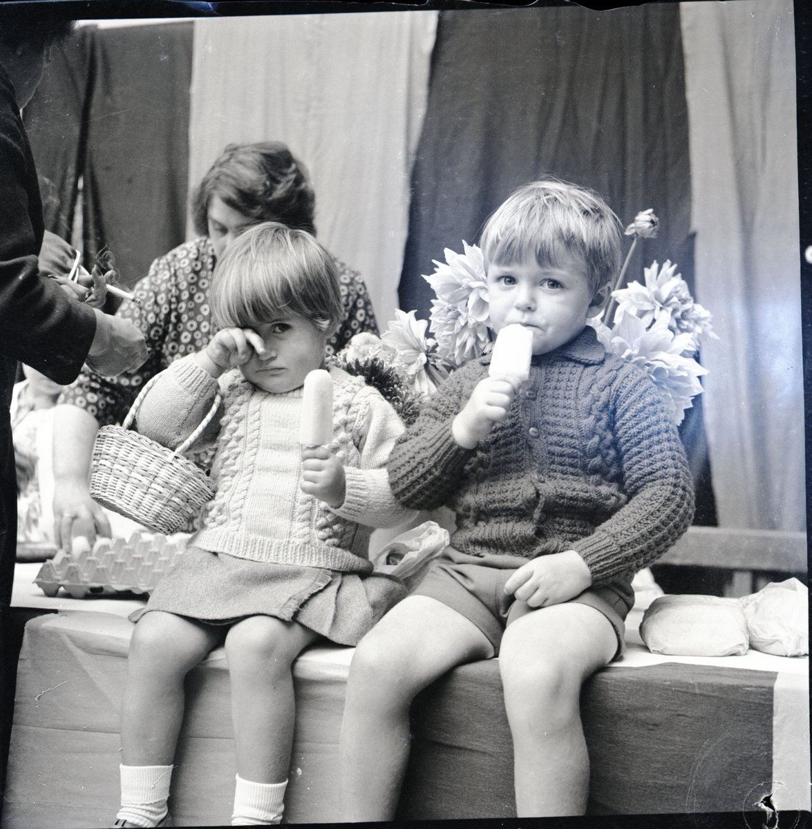 Let them eat cake....well ice lollies! Etal Flower Show 1965. Gardening has always been a large part of rural life and the annual show was always competitive! #FordandEtal #flowershow #HBAHhobbies #northumberlandpic.twitter.com/jDrFpOAJtg