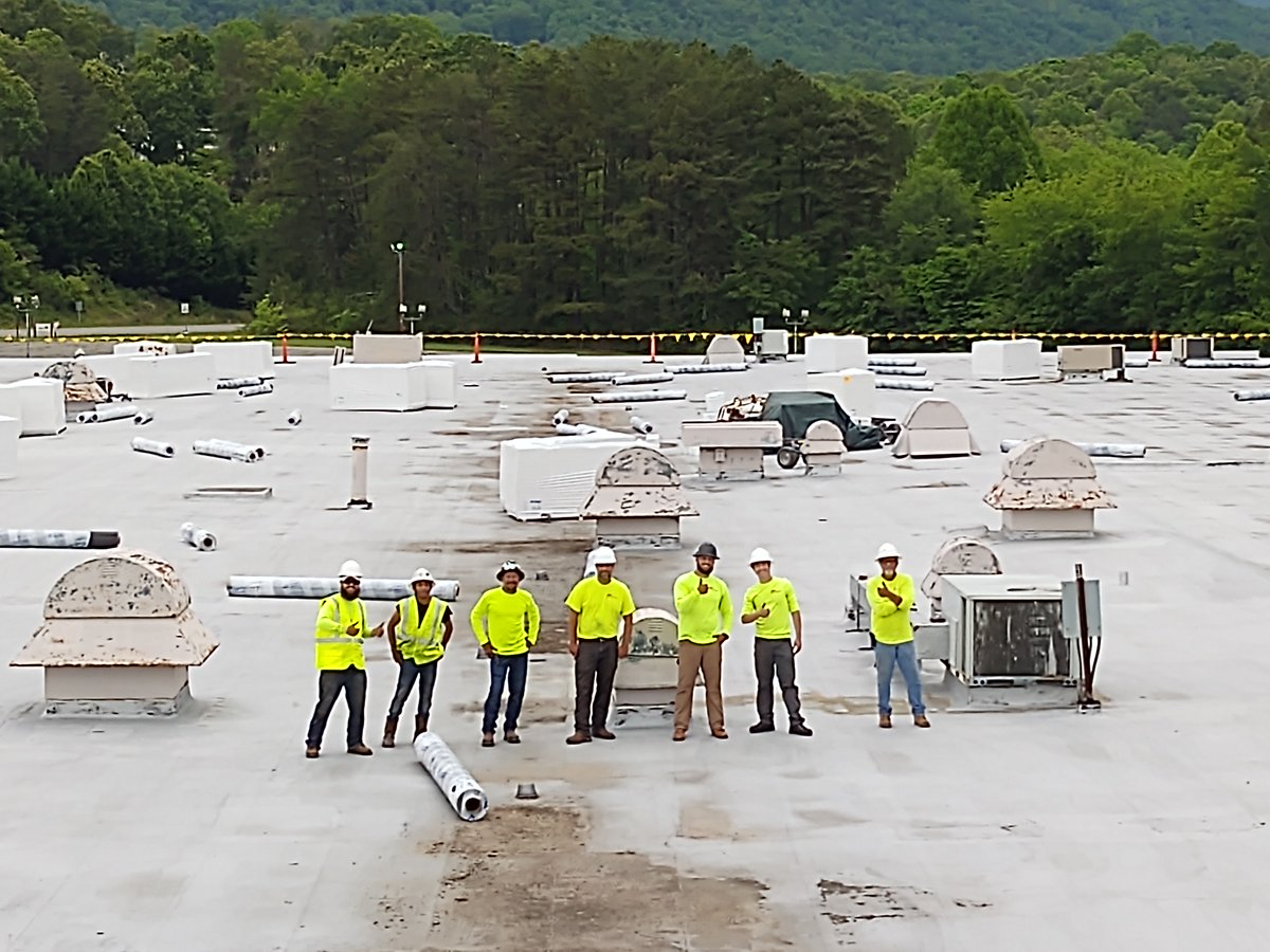 Our WNC Roofing team loading in materials for a 100,000 sq ft re-roof project in Weaverville, NC. We're here when you need us.    #commercialroofrepair #asheville #greenville