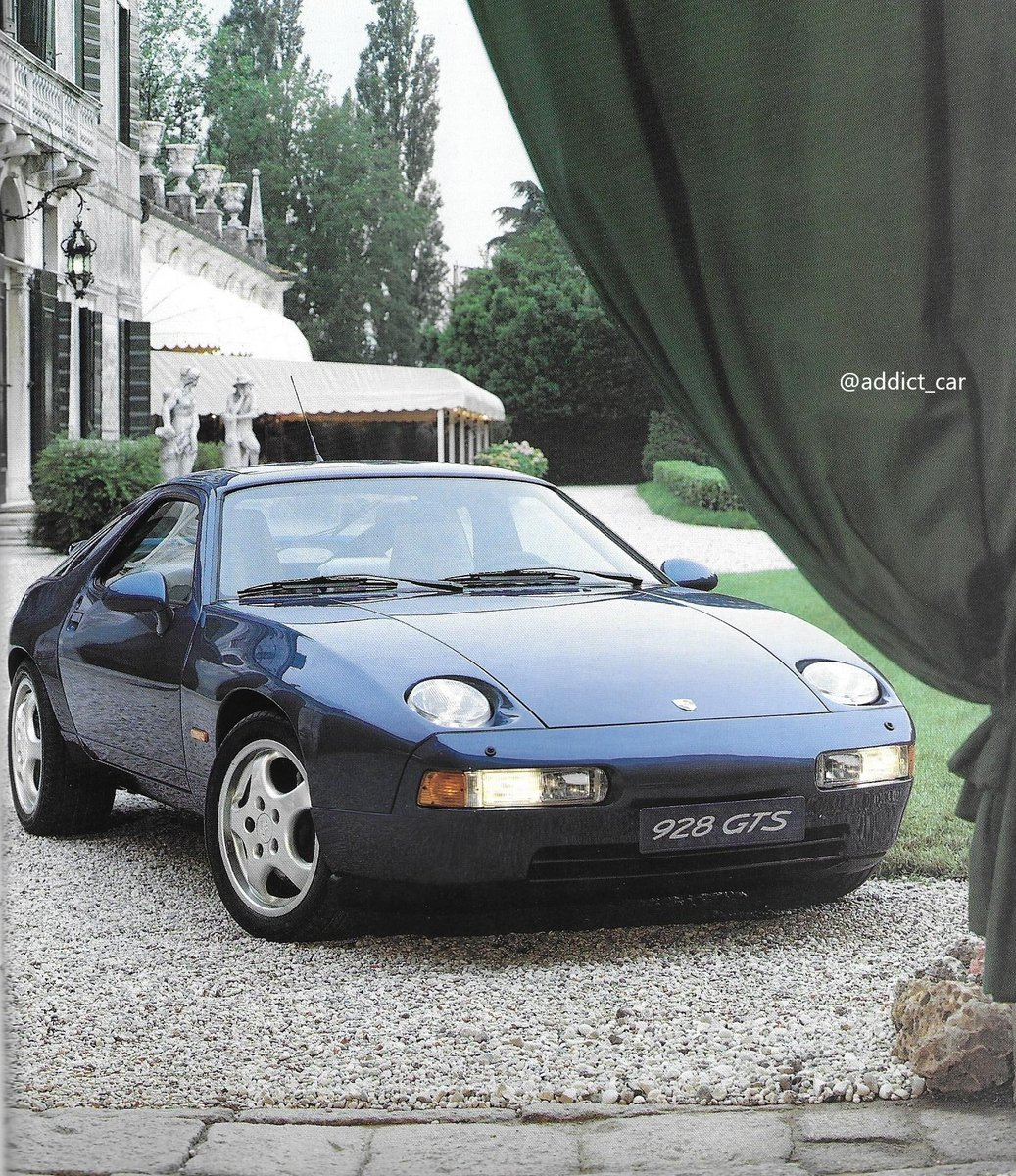 The 1992 GTS was the last evolution of the uniquely-styled Porsche 928, then nearly 15 years old. It looked more muscular, with flared rear wheel arches, new wheels and mirrors. The 5.4 litre engine was more powerful and airbags appeared for the first time. #carbrochure #Porsche