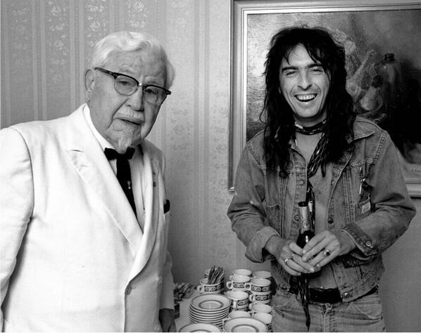 Colonel Sanders meets Alice Cooper, both known for interest in chicken, 1974: #Schultz