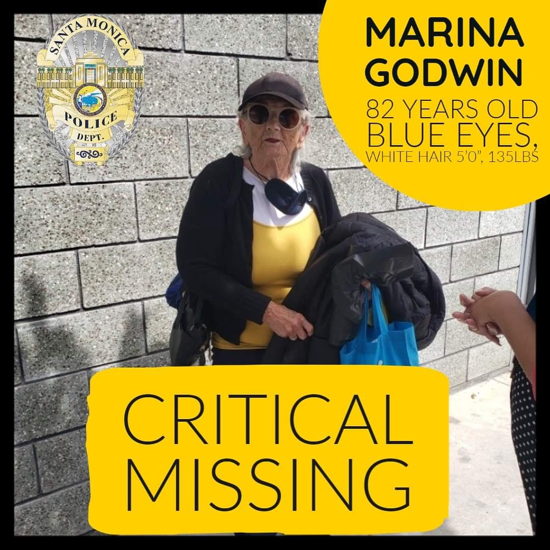 "CRITICAL MISSING - PLEASE SHARE Marina Godwin, 82 years old, Blue Eyes, White Hair, 5'0"", 135lbs Last seen wearing the clothing in the above photograph: Yellow/white blouse, black jacket, black pants, blue tennis shoes, black baseball hat, sunglasses and carrying a blue bag."