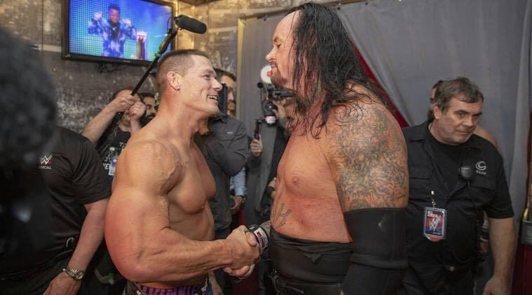 A great picture of John Cena and Undertaker after their match at WrestleMania 34. #TheLastRide<br>http://pic.twitter.com/j6dTHdUBWi