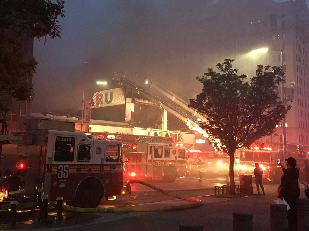 FDNY members continue to operate on scene of a 3-alarm fire at 158 West 125th Street in Manhattan.