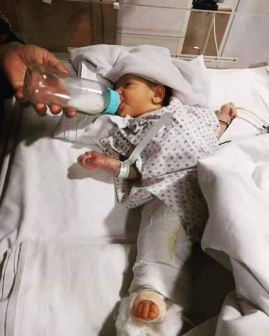 A baby girl who was shot twice in the leg during an attack on a Kabul maternity unit which killed 24 people including mothers,nurses. She survived But her mother Nazia died. Please pray for this little angel's speedy recovery. She was just three hours old when she was shot twice. <br>http://pic.twitter.com/12ewJH3XMI