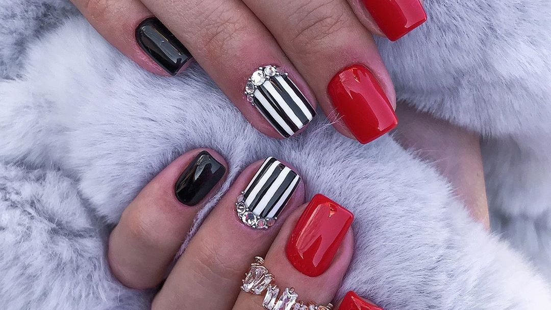 Cute red nails with black accent nail and second accent black and white striped nail with rhinestones  Tap for more  https://www.cutemanicure.com/stunning-short-red-acrylic-nails-ideas/…  @ManicureCute  #nail #nails #nailart #shortnails #rednailspic.twitter.com/uOh7Ls6xZo