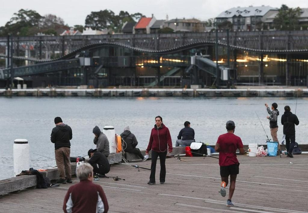 Australia opens up domestic life further as China dispute lingers reuters.com/article/us-hea…
