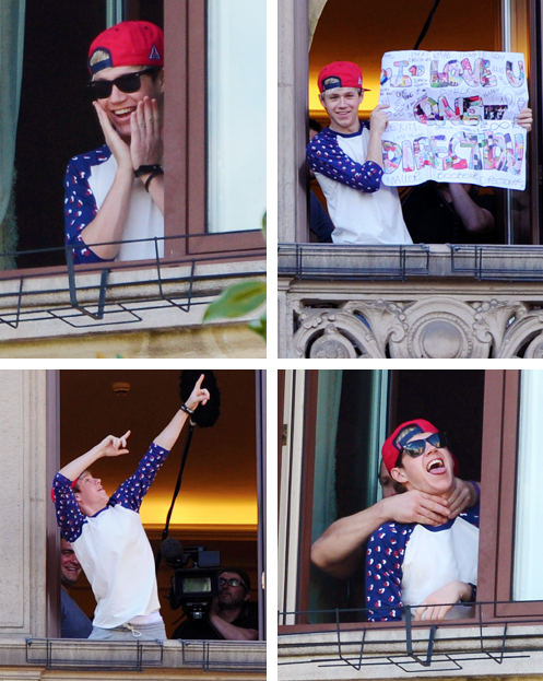 Today (May 20) in 2013 - Niall entertains the crowd (and himself) from the hotel balcony in Milan 😋😋