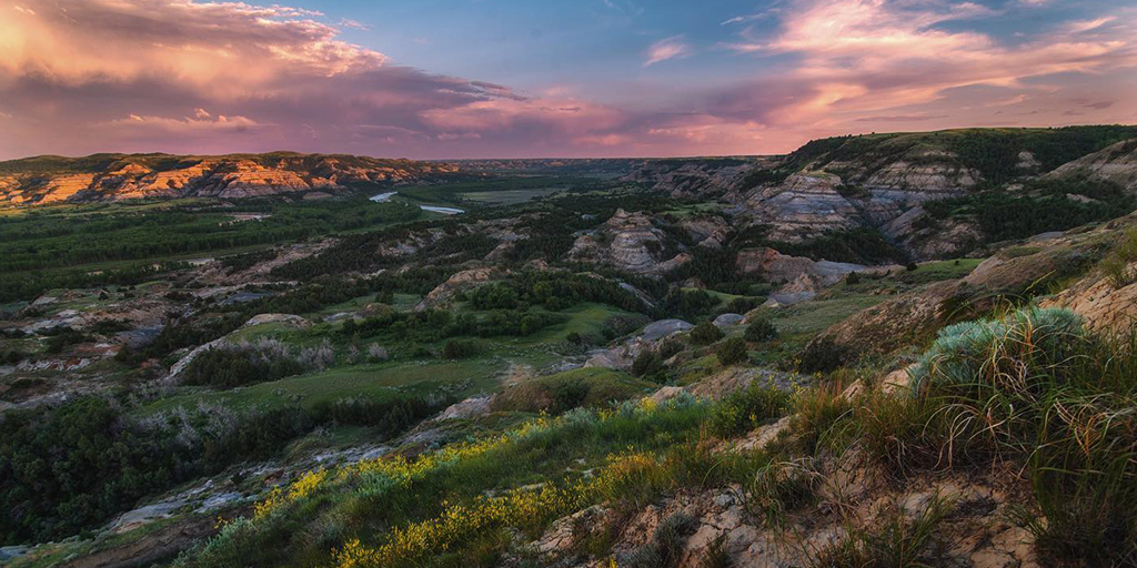 """""""There are no words that can tell the hidden spirit of the wilderness, that can reveal its mystery, its melancholy, and its charm."""" -written by Theodore Roosevelt during his time in the North Dakota badlands. #BeNDLegendary https://t.co/td7OzK23I6   📷: Beth Mancuso https://t.co/15J6naPmPV"""
