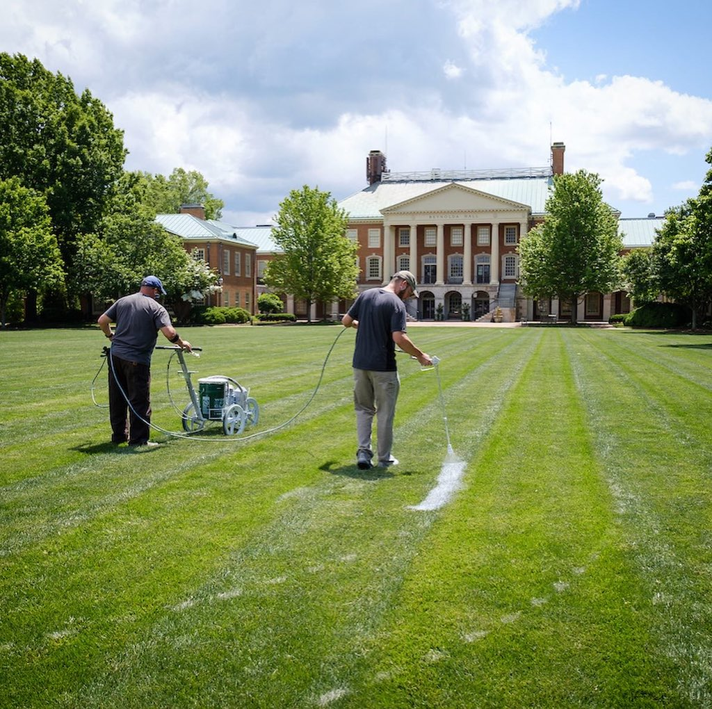 "A giant ""2020"" doesn't just magically appear on the quad! It is the product of many hours of work by @wfufacilities.Thank you to the team: Phillip Hardy, Cody Rothrock, Chris Williams, Steve Adams, Paul Sheff, Andrew Maguire, Dean Jarvis, Vance Robinette.#WFU20 #GoDeacs"