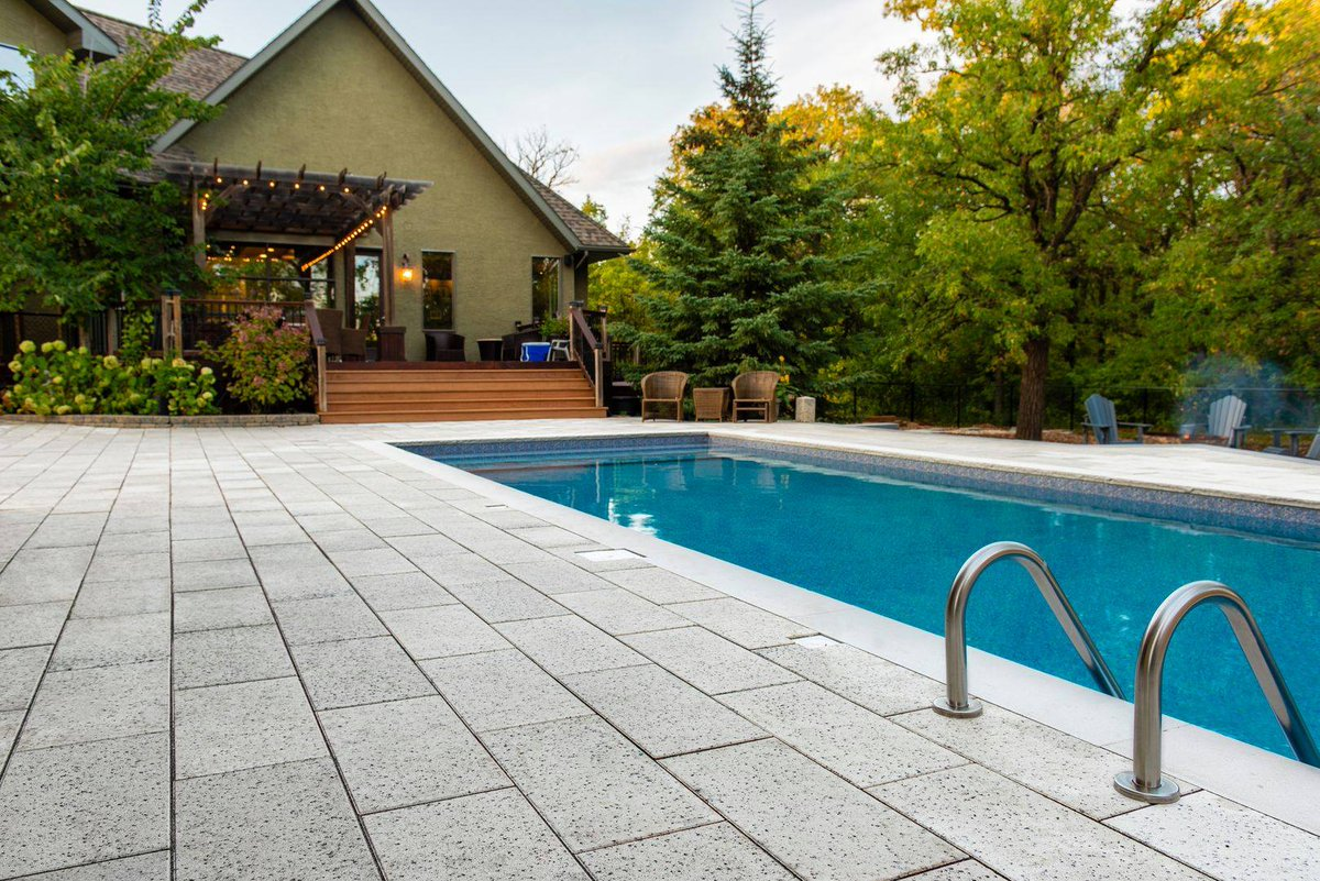 THROWBACK THURSDAY to last week when the majority of us were enjoying #poolweather .  This pool features @barkmanconcrete's Broadway Pavers in the Quartz colour which showcases a decorative, speckled look! . . . #broadwaypavers #quartz #pool #StayHomeStayCreative<br>http://pic.twitter.com/LrUohhetR9