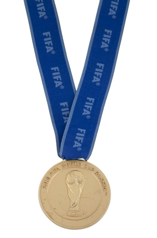 """SOLD for $71,875! A 2018 FIFA World Cup gold winner's medal awarded to a player from the champion France national football team.  Sold in today's """"Sports Legends"""" auction taking place now on Julien's Live!  #Sports #Memorabilia #Auction #JuliensAuctions #Futbol #FIFApic.twitter.com/UCzrlqb8Kq"""
