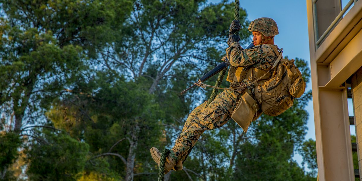 Hangin' On Lance Cpl. Elijah Gomez, a rifleman with the @15thMEUOfficial, repels during fast-rope training at @MCIWPendletonCA. Fast-rope training enables the MEU to conduct hasty insertions directly onto their objective, improving their ability to conduct missions.