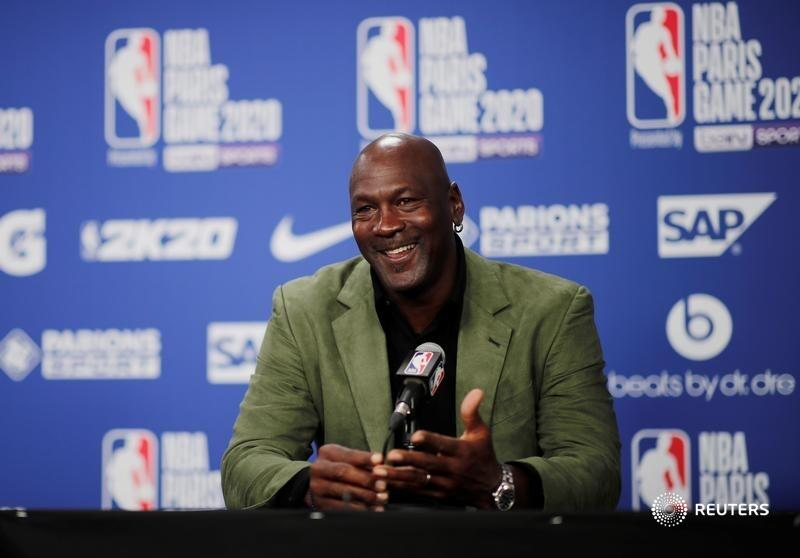 """Review: In ESPN's documentary, """"The Last Dance,"""" Michael Jordan is a reminder of when U.S. dominance looked like a slam dunk, writes @Three_Guineas. https://t.co/Sq7McjdiQS https://t.co/zMpo323Gyu"""