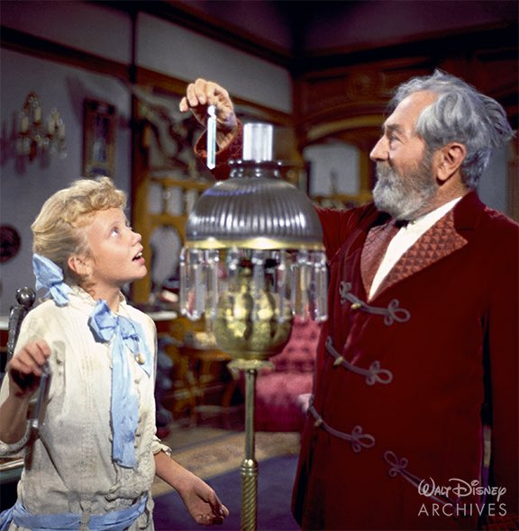 In this production photo, Mr. Pendergast (played by Adolphe Menjou) explains how refracted light works. 🌈 It's gorgeous! #D23GladGame