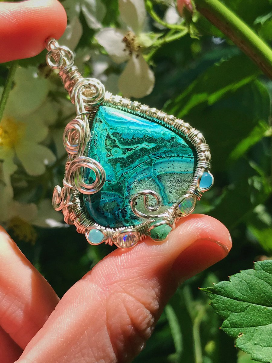 Oasis is currently $25 off on my Website  This absolutely magical creation features Malacholla, 2 Blue Topaz, 2 Ethiopian Opals & Green Tourmaline intricately Handwrapped in Sterling Silver Plated Wire   https://www. lexieslittlecreations.com/products/oasis    <br>http://pic.twitter.com/SNQ9eDWmzq