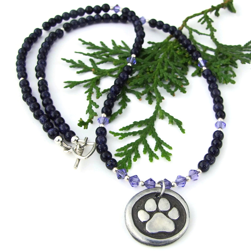 New! Two sided #dog #pawprint / #rescued pendant #necklace w/ sparkling #purple goldstone & Swarovski crystals! https://bit.ly/RescuedIM  via @ShadowDogDesign #Handmade #DogRescue #DogNecklacepic.twitter.com/hAkESPLfHq