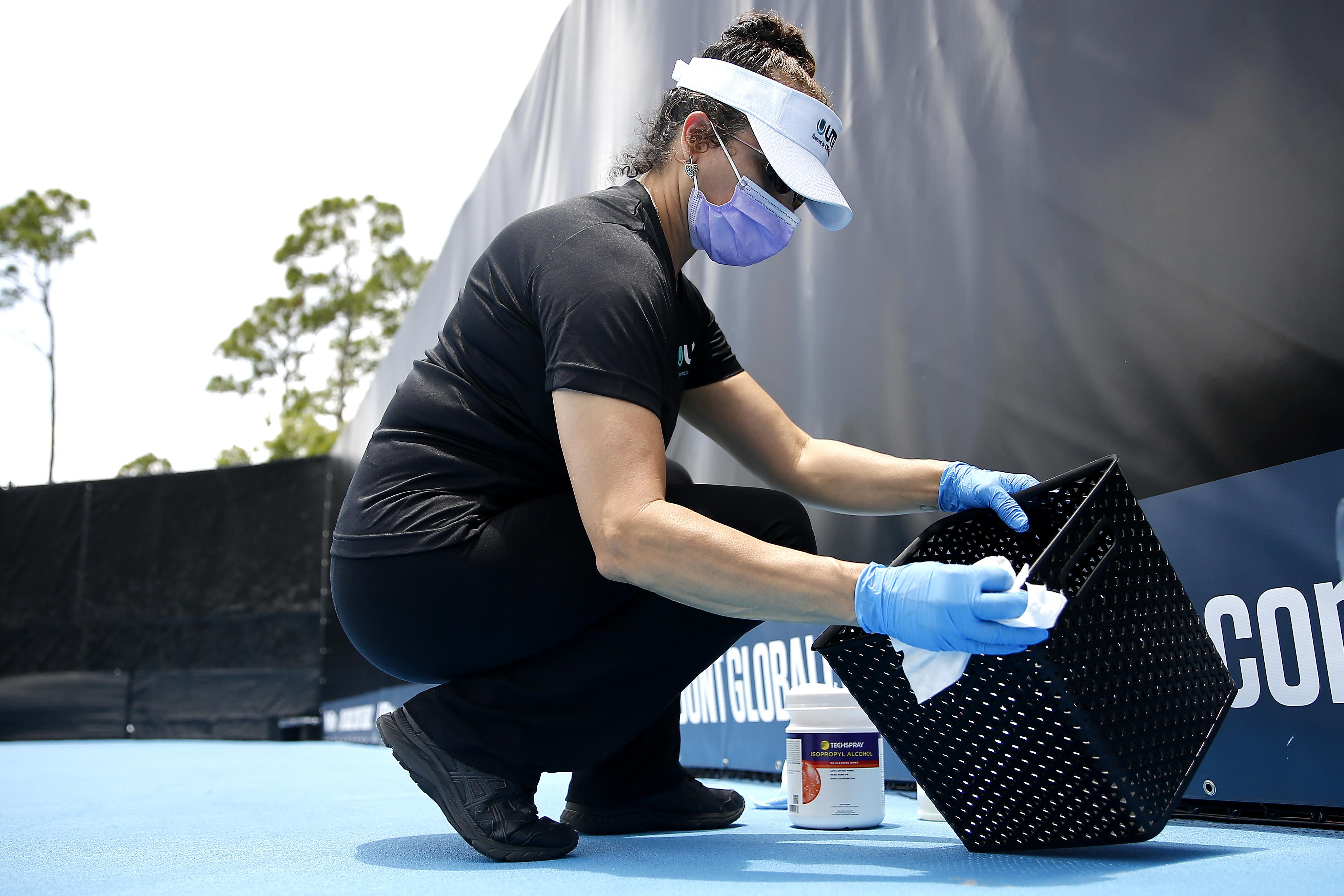 Player sanitising her basket after the match at UTR Pro Match Series. (Credits: Twitter/ UTR Pro)