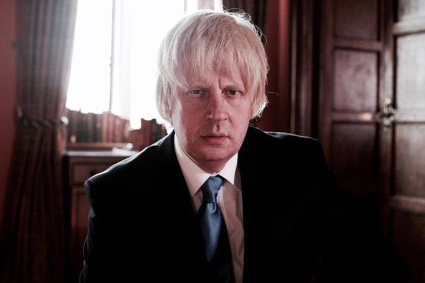 """Boris lookalike: """"Any questions?""""  Journalist: """"You're not really Boris Johnson are you? Why is the Conservative party using a lookalike to lead today's press briefing?""""  Earpiece: """"Read the emergency Latin  phrase we gave you... NOW!"""" pic.twitter.com/qhIdmZCXjy"""