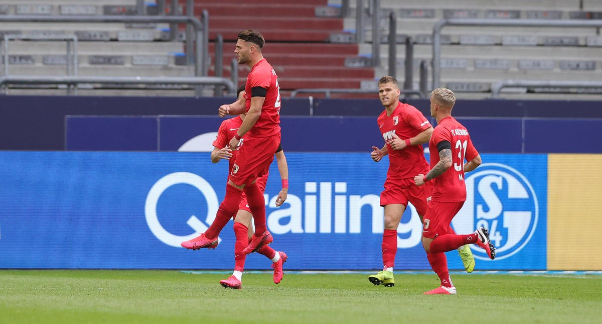 Eduard Lowen gives Augsburg the lead with a free-kick against Schalke.