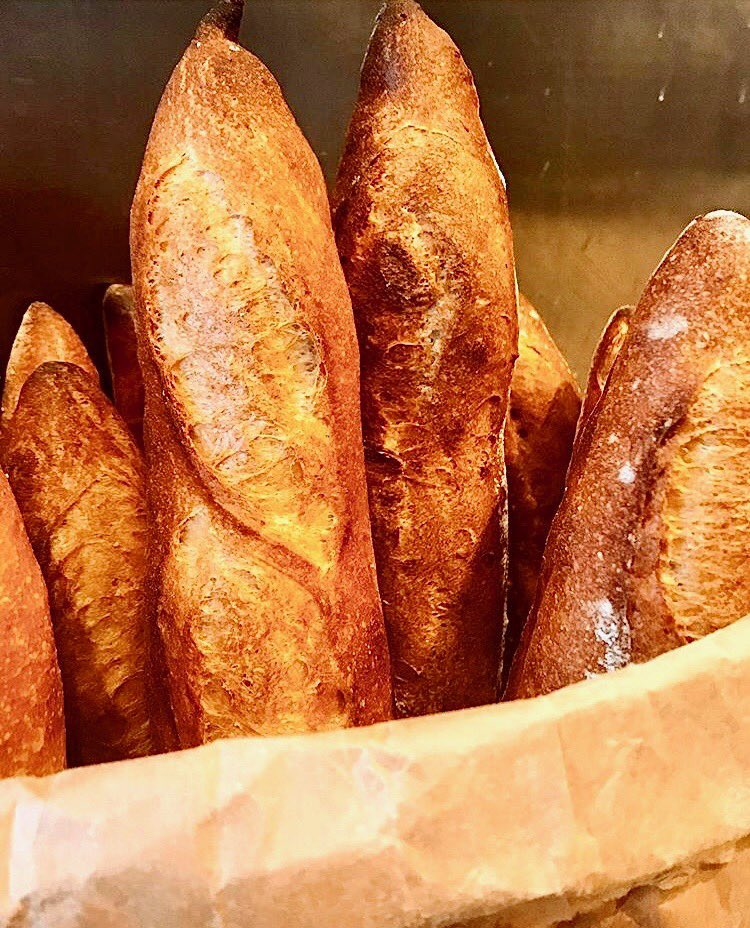 Like skyscrapers in a dense city square. Golden, crusty, delicious skyscrapers. That smell DIVINE. #baguettes #bread #breadbaking #bakeries #curbsidepickup #supportlocalbusiness #visitalexva #northernvirginiamag  #washingtonian #washingtonpostfood #northernvirginiafoodies @alxnow pic.twitter.com/OffVbQLfdo