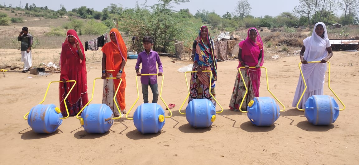 These women in Banaskantha no more carry the pot of water on head, just roll 'Water Wheel' along