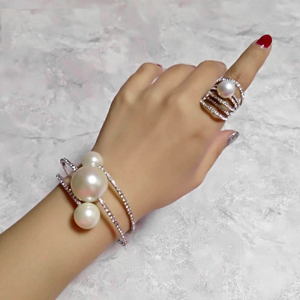 JENESIS - Big Pearl Multilayer Bangle And Rings Set - https://bit.ly/2oYg2R0   #handmade #Earrings #rbjewellerypic.twitter.com/AGTxq42qj0