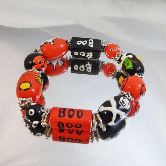 Bangle Bracelet. Halloween Bracelet. Glass Beads. Ghosts. Witches. Handmade Beads. waalaa. #vintage #antique #shopping #jewelry #jewellery #gifts #wedding #etsy http://jto.li/hhU7Spic.twitter.com/O3Vn7rcULI