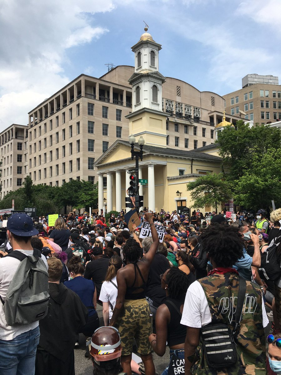 Thousands of people taking knee in Black Lives Matter Plaza