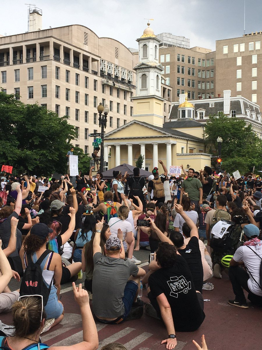 "Kneeling crowd in Black Lives Matter Plaza is being led by interpreter to ""sign her name"" ~ Breonna Taylor"