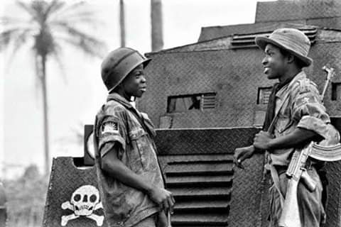 30th May Calling  2 young Biafran soldiers identified as Moise14 (L)& Ferdinand16 (R)talk to one another in Umuahia on Aug 31,1968 as d federal troops continued their genocidal advance. On Sat 30 May 2020 we shall remember those that laid down their lives 4 us to live like this 2 <br>http://pic.twitter.com/q3gykt9u4f