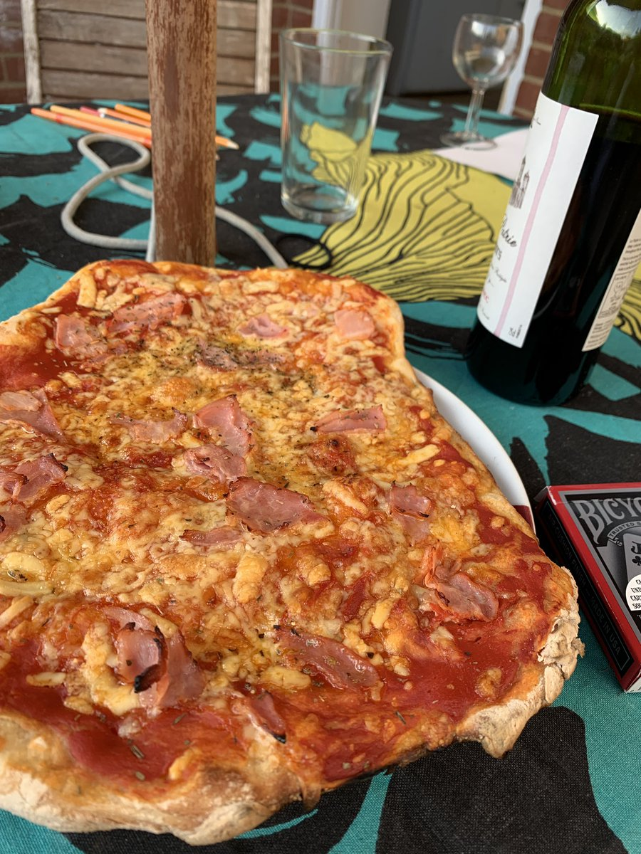 Pizza, home made in the BBQ and wine.