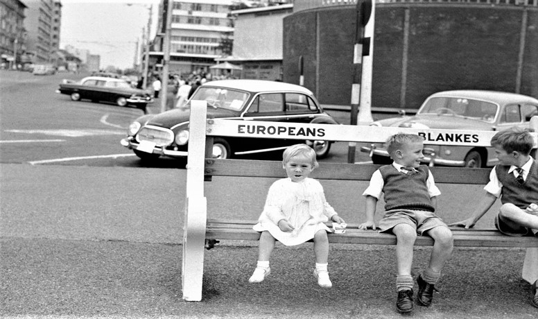 Children sit on a bench along waterfront in Durban #SouthAfrica on 27 May 1960; park benches like this were reserved for whites only <br>http://pic.twitter.com/SziFLU04vL