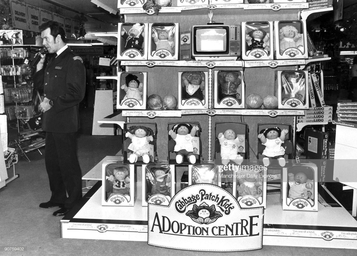 """Cabbage Patch Kids """"adoption centre"""" at an unnamed store in Manchester England 1983. Photo from the Manchester Daily Express via Getty Images. #1980s #80s #BackInTheDay pic.twitter.com/9BnOi1183E"""