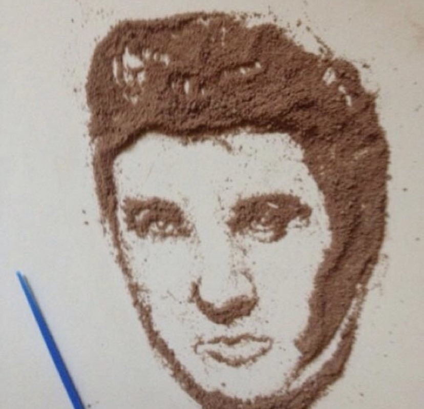You are cleaning the counter and your son has spilled Hershey Cocoa Mix and then created this. Wipe it up or leave it forever??? #ElvisPresley @Hersheys