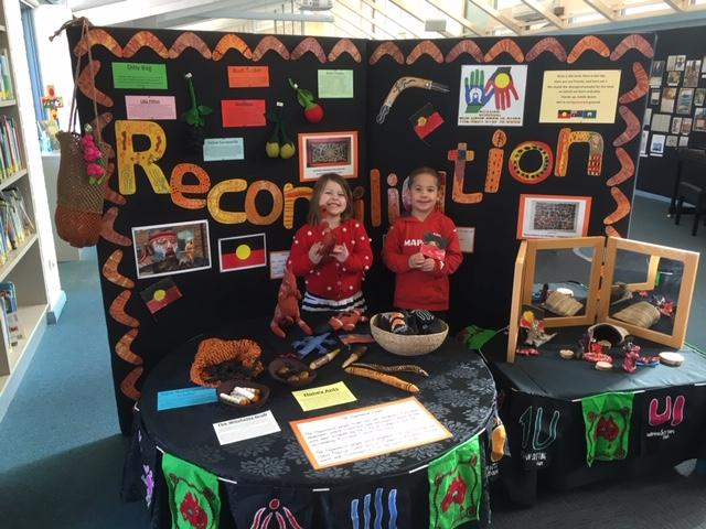 #NRW2020 has involved lots of learning! The students at the Campbell campus have built a Reconciliation display. Joshua is showing the Aboriginal Flag that he painted while Henley is showing one of the rare and beautiful Australian birds that is found nowhere else but Australia.