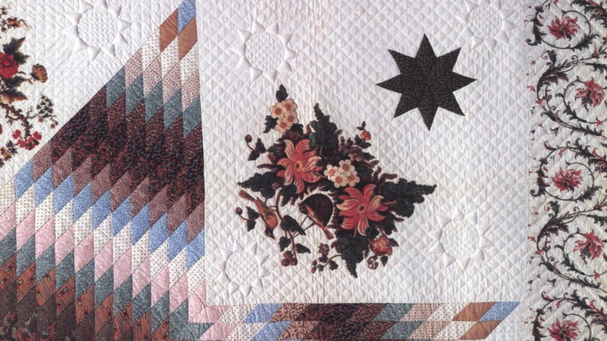 """Detail from a page of """"American Quilts and Coverlets in The Metropolitan Museum of Art"""" showing a multicolored quilt."""
